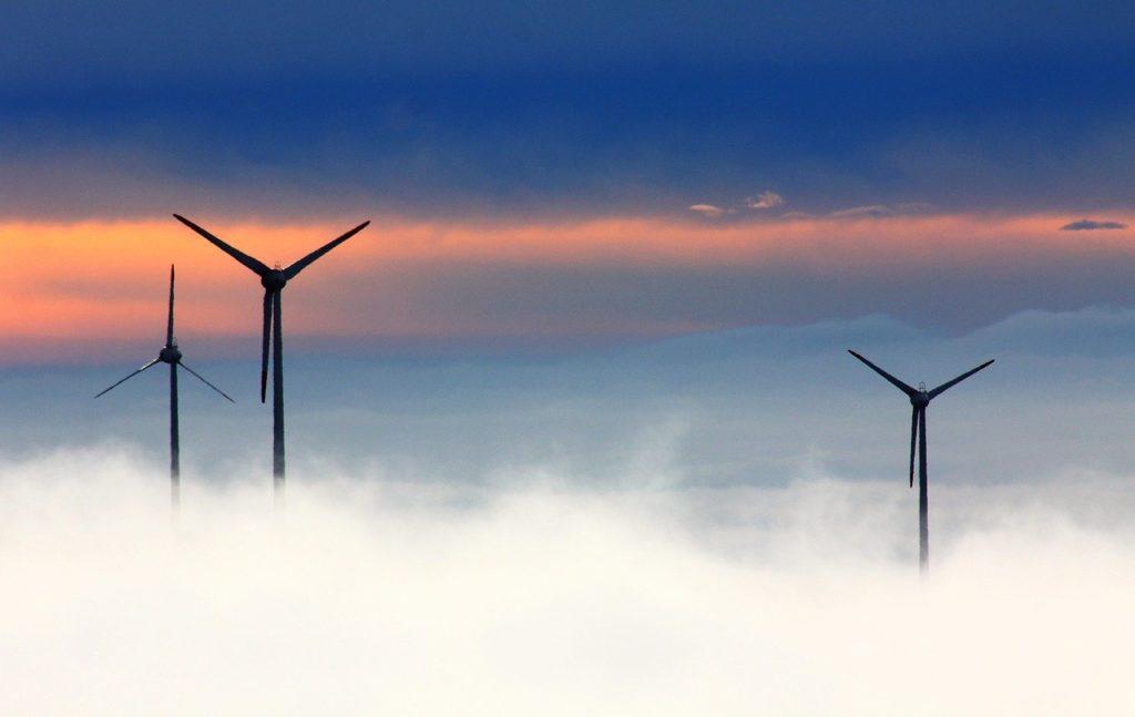windmills, clouds, fog